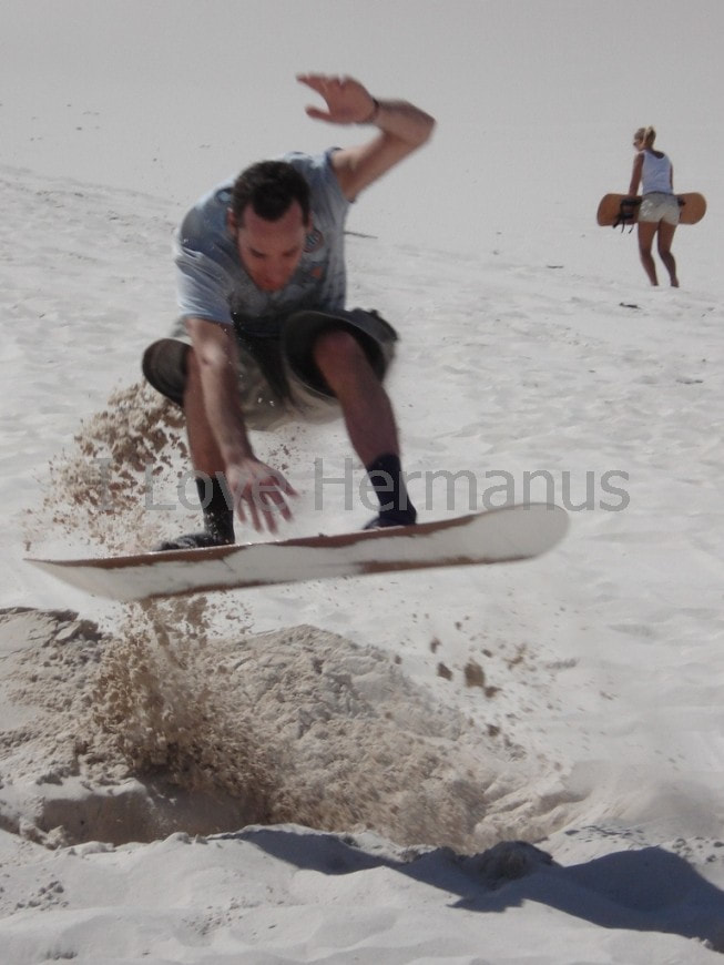 Sandboarding the dunes near Hermanus, near Cape Town, South Africa